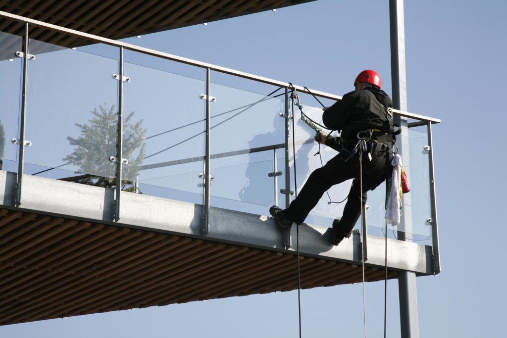 professional exterior cleaner cleaning commercial windows