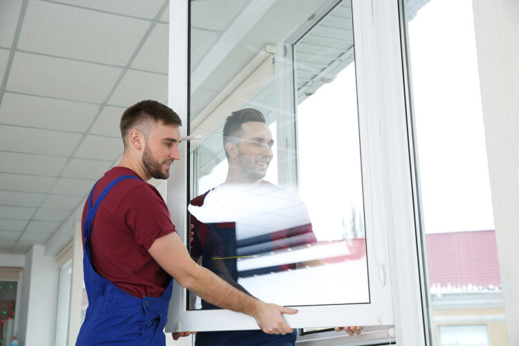 professional exterior cleaner cleaning windows